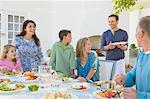 Family having breakfast at the dining table Stock Photo - Premium Royalty-Free, Artist: Blend Images, Code: 6108-05874324