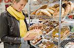 Woman choosing breads in a supermarket Stock Photo - Premium Royalty-Free, Artist: CulturaRM, Code: 6108-05874423