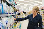 Woman shopping in a supermarket Stock Photo - Premium Royalty-Free, Artist: Cultura RM, Code: 6108-05874426