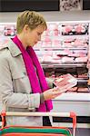 Woman shopping in a supermarket Stock Photo - Premium Royalty-Free, Artist: photo division, Code: 6108-05874433