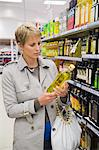 Woman buying beverages in a store Stock Photo - Premium Royalty-Free, Artist: Raymond Forbes, Code: 6108-05874435