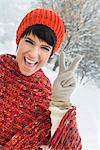 Young woman in winter clothes making peace sign Stock Photo - Premium Royalty-Free, Artist: AWL Images, Code: 6108-05874543
