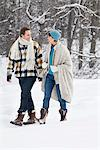 Young couple looking at each other, walking in snow Stock Photo - Premium Royalty-Free, Artist: AWL Images, Code: 6108-05874549