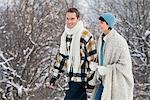 Young couple walking in snow Stock Photo - Premium Royalty-Free, Artist: Michael Mahovlich, Code: 6108-05874550