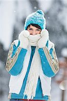 Young woman in winter clothes smiling at camera Stock Photo - Premium Royalty-Freenull, Code: 6108-05874562
