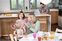 preteen kissing - Family at a breakfast table Stock Photo - Premium Royalty-Freenull, Code: 6108-05874619