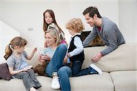 preteen girl - Family in a living room Stock Photo - Premium Royalty-Freenull, Code: 6108-05874641