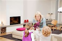 Woman giving a potted plant to her grandchildren Stock Photo - Premium Royalty-Freenull, Code: 6108-05874649