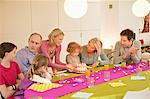 Family at a birthday celebration Stock Photo - Premium Royalty-Free, Artist: CulturaRM, Code: 6108-05874652
