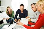 Two couples examining blueprints at home Stock Photo - Premium Royalty-Free, Artist: Blend Images, Code: 6108-05874837