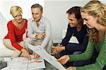 Two couples examining blueprints at home Stock Photo - Premium Royalty-Free, Artist: Mark Leibowitz, Code: 6108-05874840