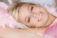 feather  close-up - Close-up of woman's face smiling Stock Photo - Premium Royalty-Freenull, Code: 6108-05874845