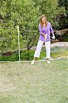 Young woman playing paddle ball in a garden Stock Photo - Premium Royalty-Free, Artist: Robert Harding Images, Code: 6108-05875101