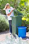 Woman looking into recycling bin Stock Photo - Premium Royalty-Free, Artist: Cultura RM, Code: 6108-05875116