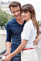 Couple locking a padlock of love on a bridge, Pont des Arts, Paris, Ile-de-France, France Stock Photo - Premium Royalty-Freenull, Code: 6108-05875151