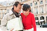 Couple smiling on a street, Paris, Ile-de-France, France Stock Photo - Premium Royalty-Free, Artist: Ikon Images, Code: 6108-05875167
