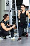Sporty couple exercising at the fitness gym Stock Photo - Royalty-Free, Artist: dash                          , Code: 400-05875793