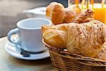 Breakfast with coffee and croissants in a basket on table Stock Photo - Royalty-Free, Artist: ilolab                        , Code: 400-05877014