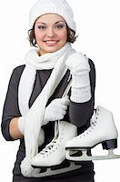 Pretty girl with figure skates on her shoulders Stock Photo - Royalty-Freenull, Code: 400-05877830
