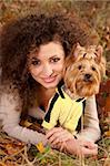 woman with curls and a little dog in nature, fall Stock Photo - Royalty-Free, Artist: artfotoss                     , Code: 400-05880310