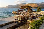 Traditional water mill at the sinkholes on Lassi area of Kefalonia island in Greece Stock Photo - Royalty-Free, Artist: karapas                       , Code: 400-05880375