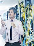 young handsome business man  engeneer in datacenter server room Stock Photo - Royalty-Free, Artist: dotshock                      , Code: 400-05881499