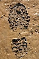 Walker?s Boot print in wet mud Stock Photo - Royalty-Freenull, Code: 400-05889330