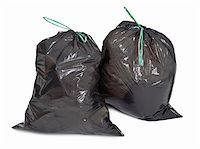 two tied garbage bags on white background Stock Photo - Royalty-Freenull, Code: 400-05891352