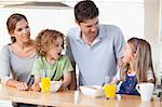 Family having breakfast in their kitchen Stock Photo - Royalty-Free, Artist: 4774344sean                   , Code: 400-05895135