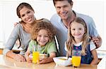 Happy family having breakfast in their kitchen Stock Photo - Royalty-Free, Artist: 4774344sean                   , Code: 400-05895136