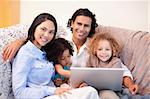 Young family using laptop on the sofa together Stock Photo - Royalty-Free, Artist: 4774344sean                   , Code: 400-05897778