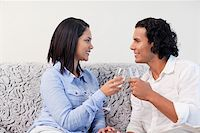 Young couple having sparkling wine on the sofa Stock Photo - Royalty-Freenull, Code: 400-05897838