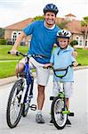 A young family of man and boy, father and one boy child, cycling together. Stock Photo - Royalty-Free, Artist: darrenbaker                   , Code: 400-05898150