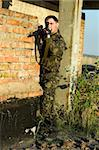 sniper in camouflage ambushing behind brick wall Stock Photo - Royalty-Free, Artist: acidgrey                      , Code: 400-05898887
