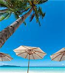 white parasols on a tropical beach Stock Photo - Royalty-Free, Artist: hansenn                       , Code: 400-05899342