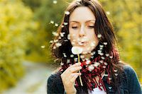 Girl blowing on white dandelion in the forest Stock Photo - Royalty-Freenull, Code: 400-05899557