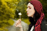 Girl blowing on white dandelion in the forest Stock Photo - Royalty-Freenull, Code: 400-05899559