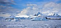 Beautiful snow-capped mountains against the blue sky in Antarctica Stock Photo - Royalty-Freenull, Code: 400-05899588