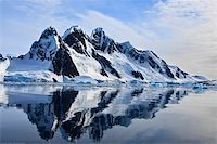 Beautiful snow-capped mountains against the blue sky in Antarctica Stock Photo - Royalty-Freenull, Code: 400-05899635