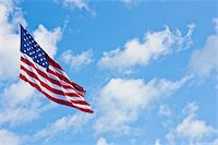flag at half mast - American flag on a blue sky during a windy day Stock Photo - Royalty-Freenull, Code: 400-05902840