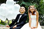Portrait of children bride and groom with balloons sitting in park Stock Photo - Royalty-Free, Artist: pressmaster                   , Code: 400-05904070