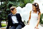 Portrait of children bride and groom with balloons chatting in park Stock Photo - Royalty-Free, Artist: pressmaster                   , Code: 400-05904071