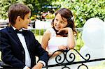Portrait of boy groom and his cute bride chatting in park Stock Photo - Royalty-Free, Artist: pressmaster                   , Code: 400-05904087