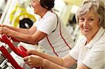 Portrait of two good-looking senior women training on exercise machines Stock Photo - Royalty-Free, Artist: pressmaster                   , Code: 400-05904093