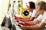 Two senior women exercising on training machines Stock Photo - Royalty-Free, Artist: pressmaster                   , Code: 400-05904094