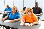 Diverse adult education or college class taking a test. Stock Photo - Royalty-Free, Artist: lisafx                        , Code: 400-05906320