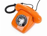 classic dial phone on white background Stock Photo - Royalty-Freenull, Code: 400-05912092