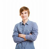 Happy young man with arms folded, isolated over a white background Stock Photo - Royalty-Freenull, Code: 400-05912400