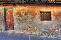 Old vintage abandoned house with small window and wooden door in town of La Morra, Northern Italy. Stock Photo - Royalty-Freenull, Code: 400-05915532
