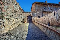 Narrow stone paved street among ancient wall and old house in town of Serralunga D'Alba, Northern Italy. Stock Photo - Royalty-Freenull, Code: 400-05916712
